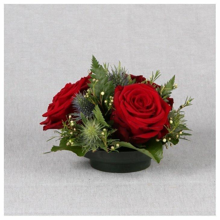 Gravdekoration med røde roser